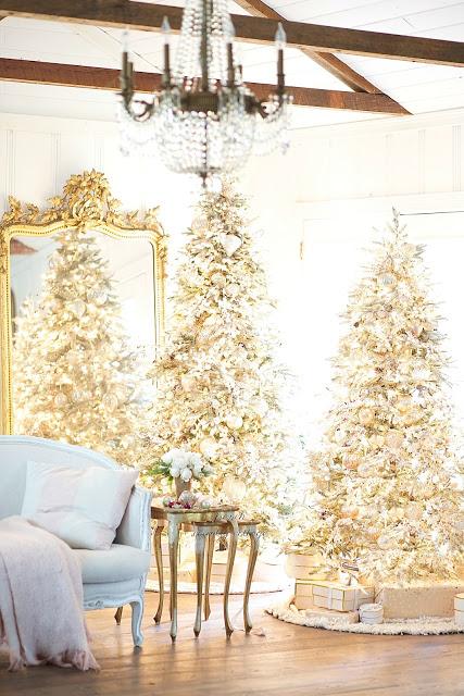 living room with pre-lit christmas trees
