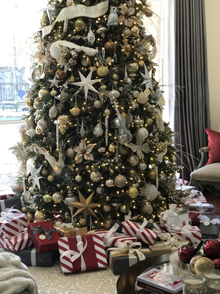 christmas tree decorated with silver and gold ornaments