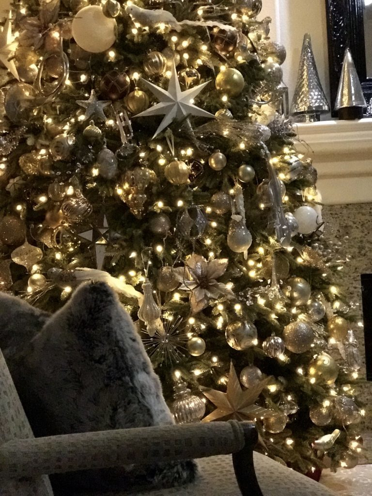 decorated pre-lit christmas tree in silver and gold