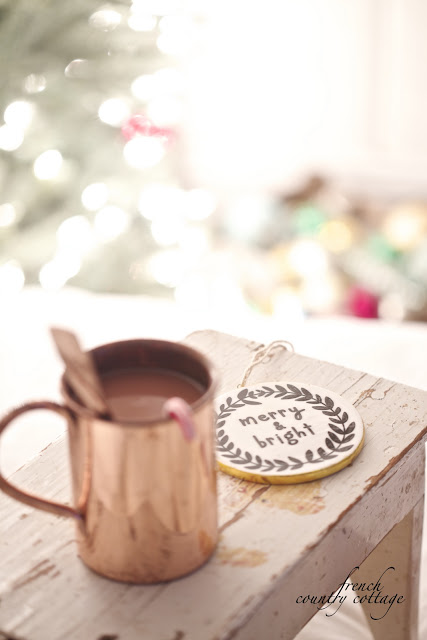 Copper mug and Christmas coaster on top of a vintage wooden stool