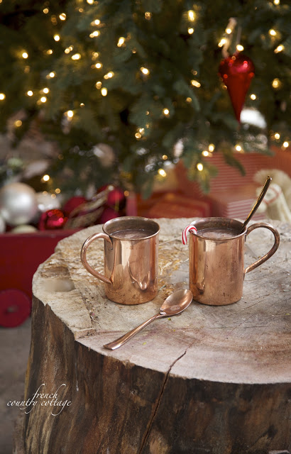 Closeup shot of two copper mugs and a copper spoon