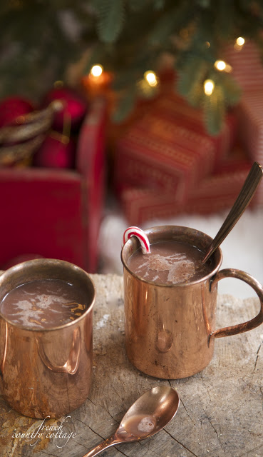 Closeup shot of two copper mugs filled with hot cocoa