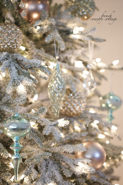 Frosted Christmas tree with winter-themed glass decorations