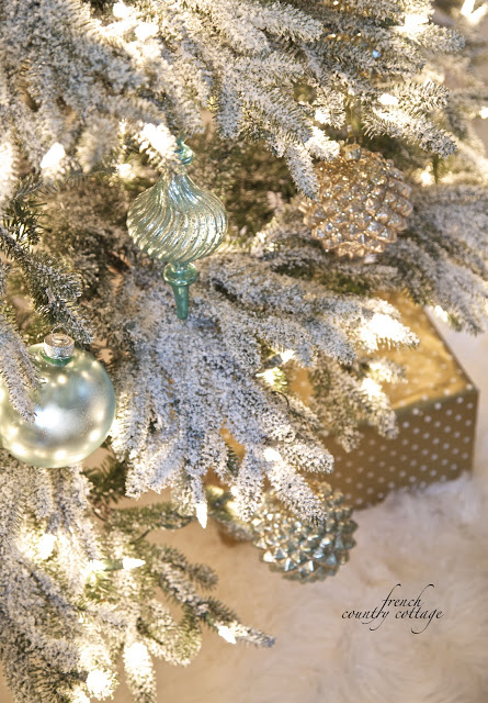 Close up of decorated artificial pre-lit frosted Christmas tree