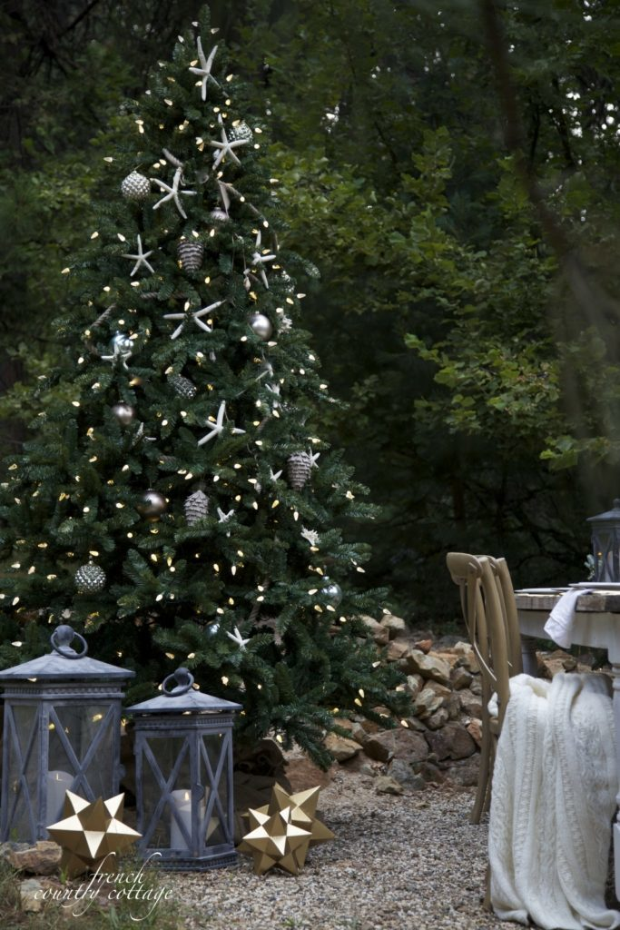 Full shot of artificial outdoor Christmas tree decorated with seaside theme