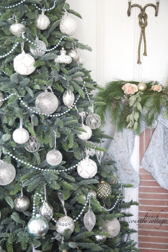 Christmas tree decorated with white and vintage ornaments