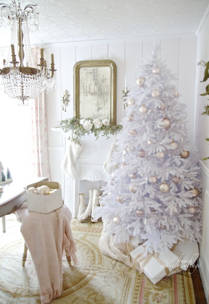 White artificial Christmas tree with blush-hued ornaments