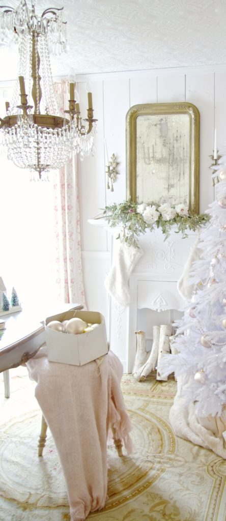 Room decorated with a white Christmas tree