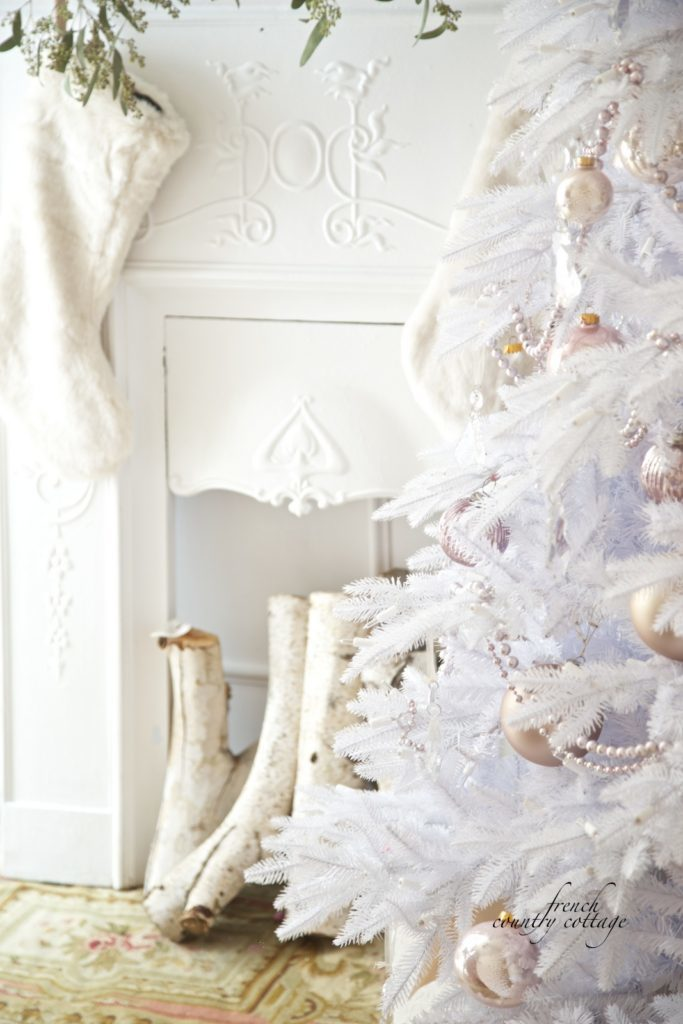 Decorated white Christmas tree with blush-hued ornaments