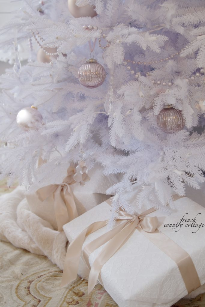 White Christmas tree with dainty, blush-hued ornaments