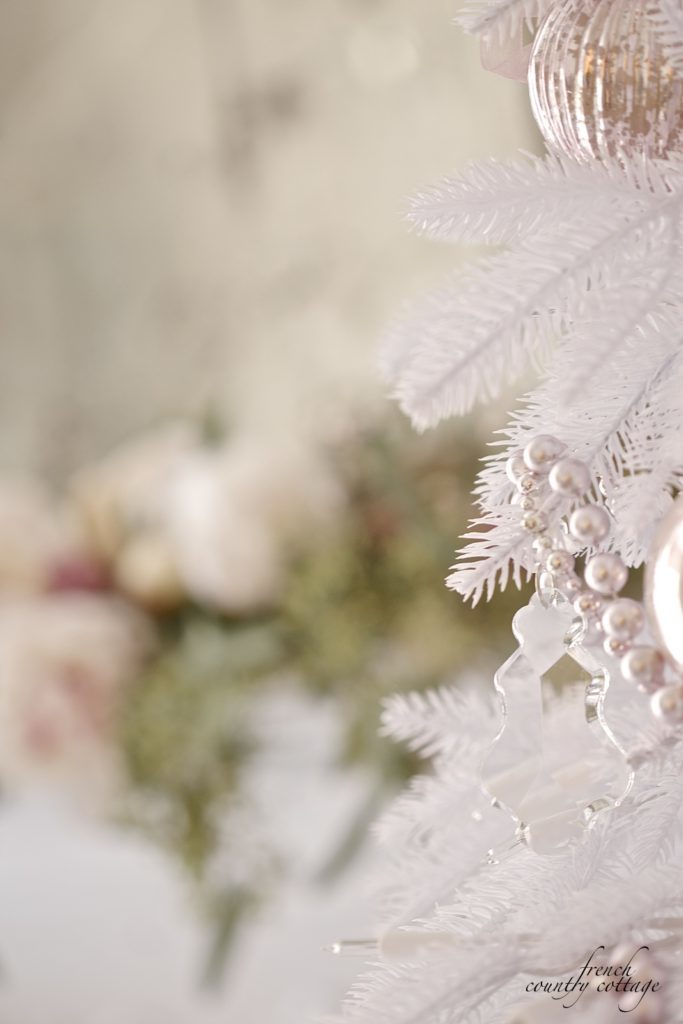 Close-up of white Christmas tree with blush-hued ornaments
