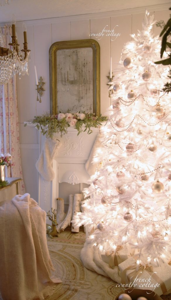 White pre-lit Christmas tree with blush-hued ornaments