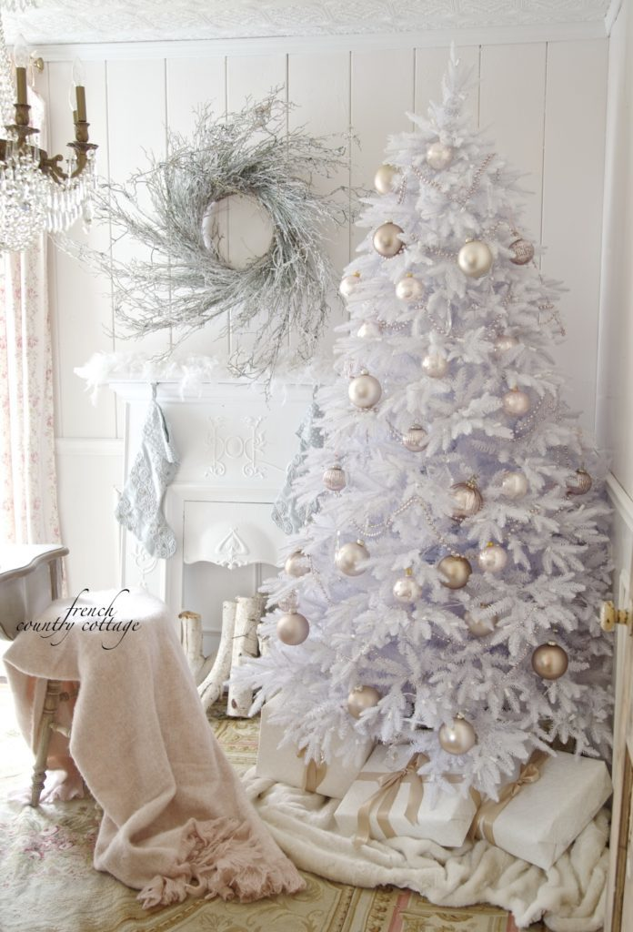 White Christmas tree with blush-hued ornaments
