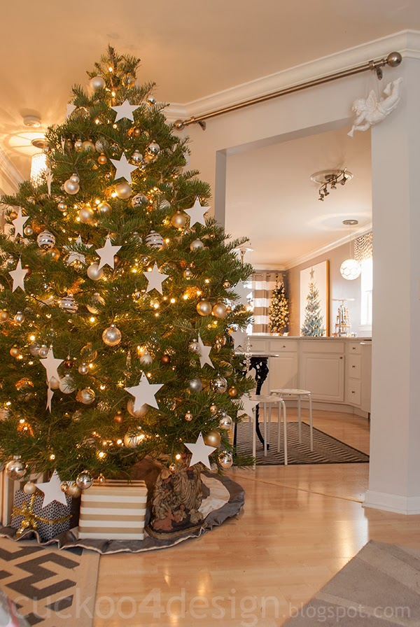 Balsam Hill Christmas tree decorated with white, cream, gold, silver balls and white star ornaments in living room