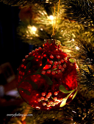 Closeup shot of a red Christmas ornament embellished with beads