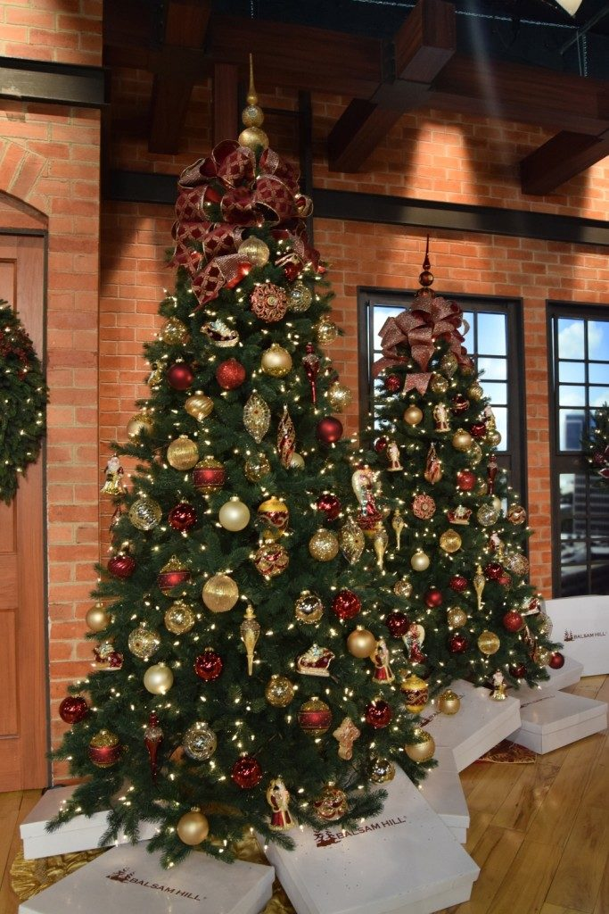 Artificial Christmas trees decorated with classic red and gold theme
