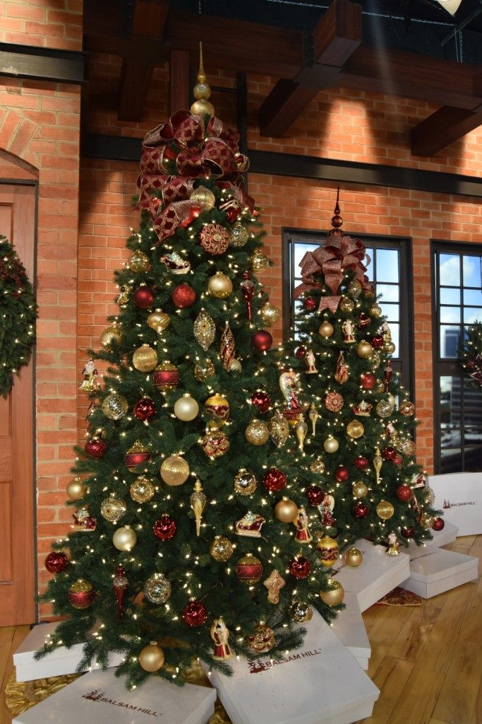 Full shot of artificial Christmas tree with ornaments and decorations
