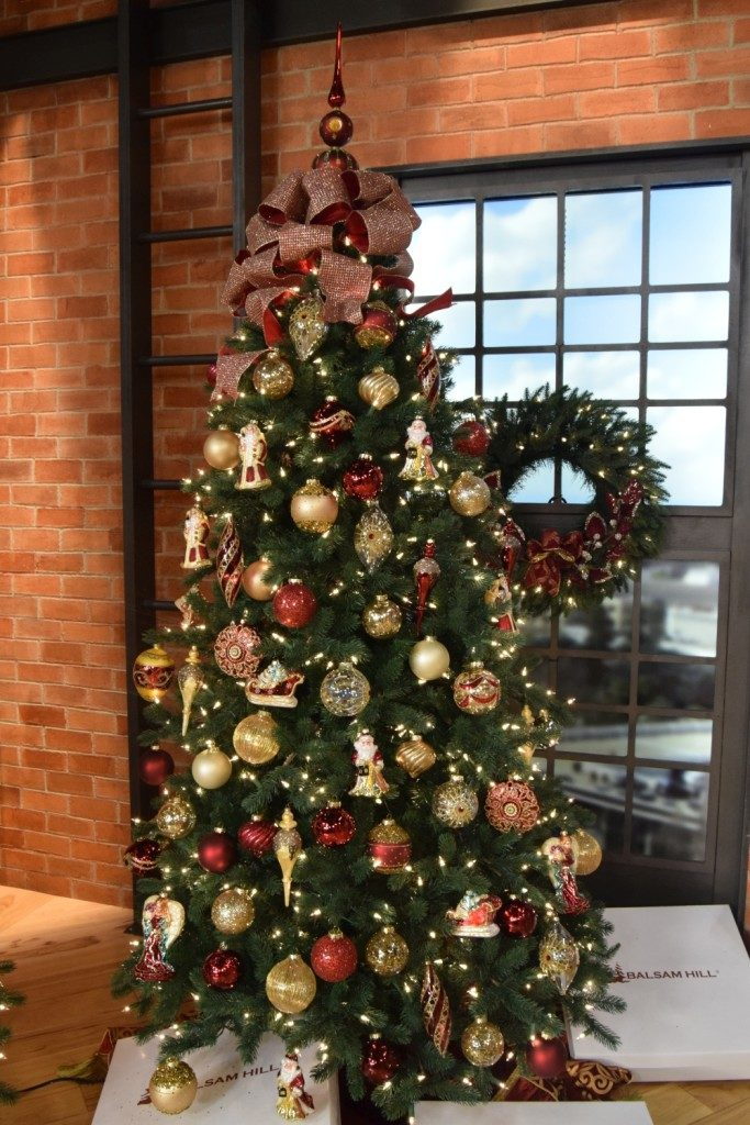 Artificial Christmas tree decorated with classic theme