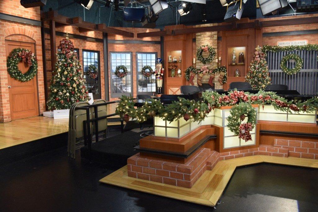 Pre-lit artificial Christmas trees and foliage studio display