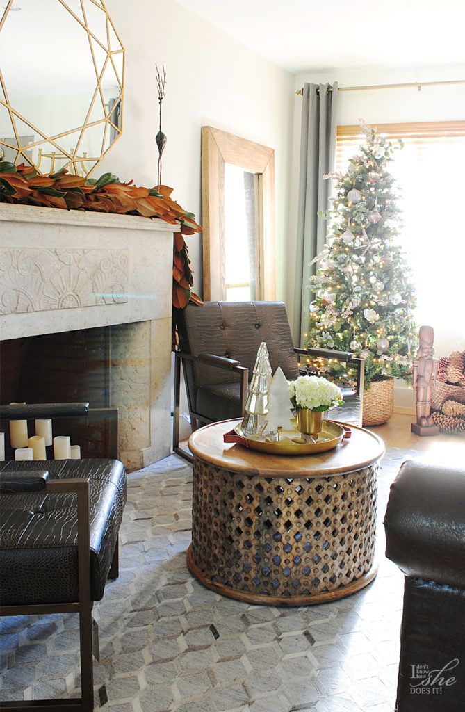 Wide shot of room with a Christmas tree placed by the window