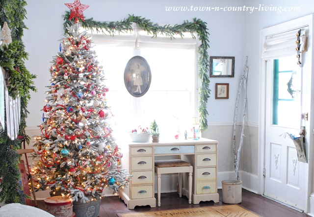 Frosted Christmas tree with vintage glass ornaments