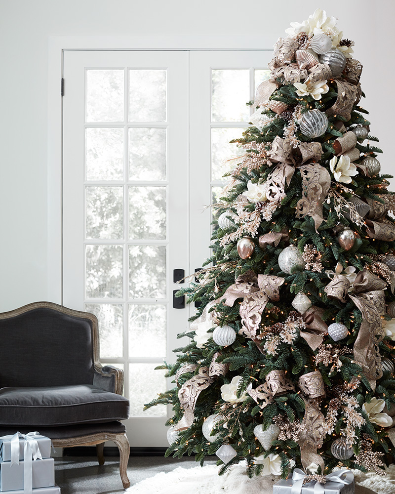 Full shot of artificial Christmas tree with french country ornaments