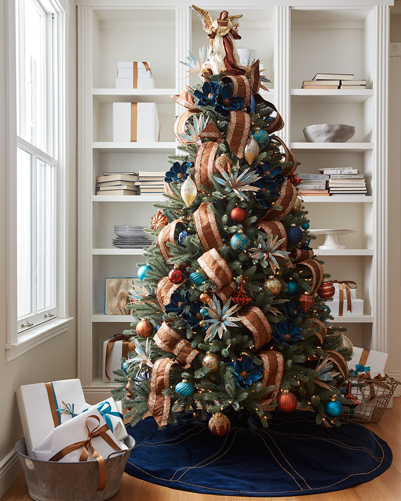 full shot of brown and blue theme christmas tree