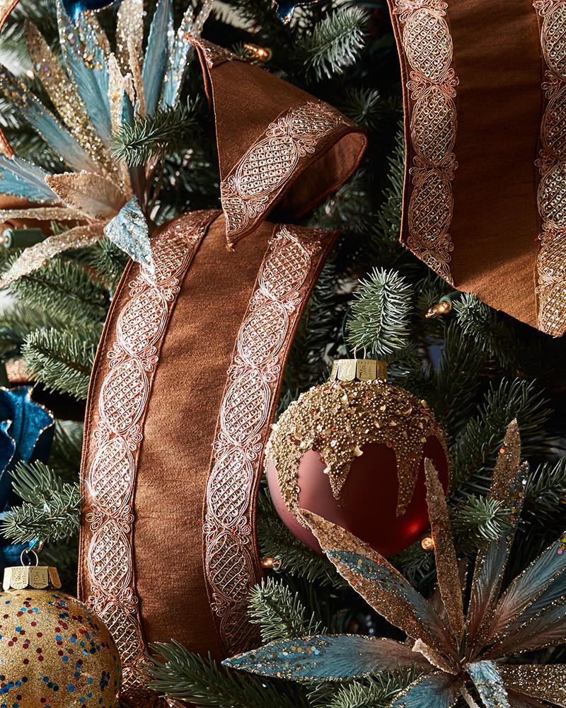 christmas tree ribbon, floral picks, and ornaments