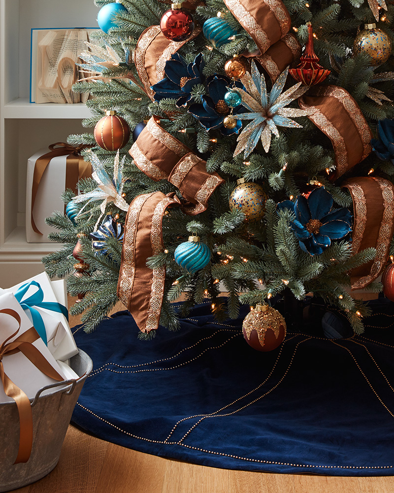 tree with ribbon, floral picks, and ornaments
