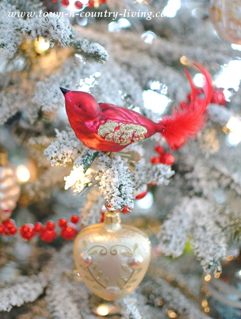 Glass bird vintage ornament on tree