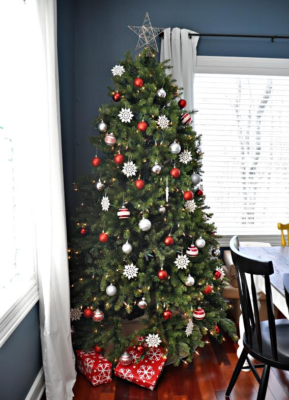 full shot of christmas tree decorated with red and white theme
