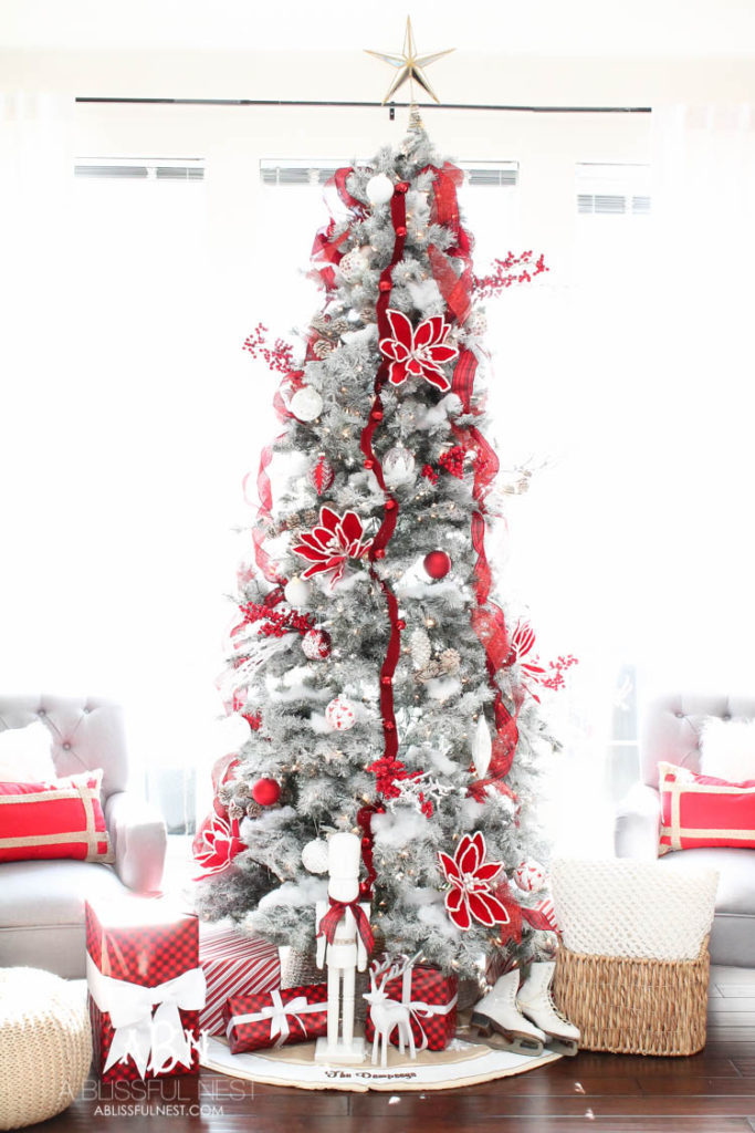Artificial Christmas tree decorated with traditional red and white theme