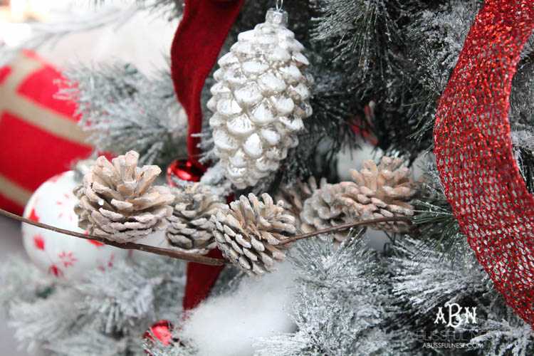Closeup of frosted pinecone Christmas tree ornaments