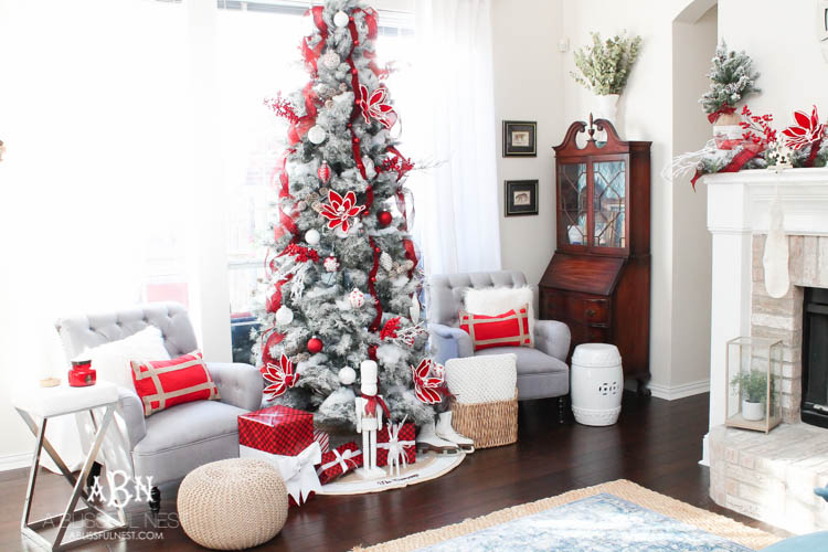 Artificial Christmas tree decorated with red and white trimmings