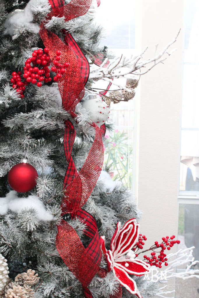 Decorated frosted Christmas tree with red and white theme