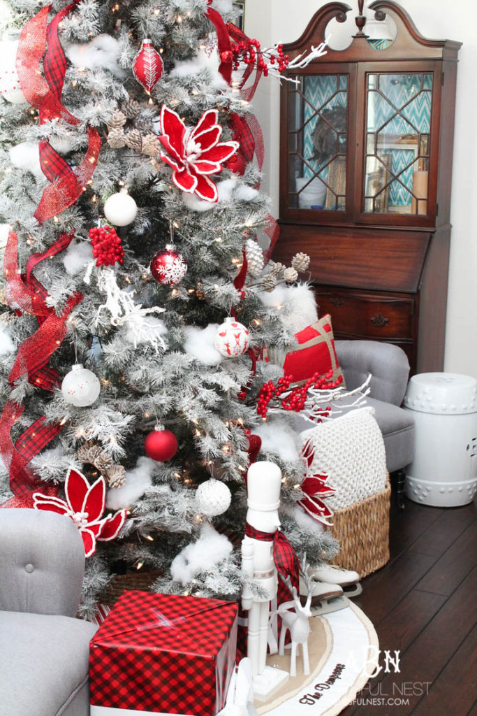 Artificial frosted Christmas tree decorated with red and white theme