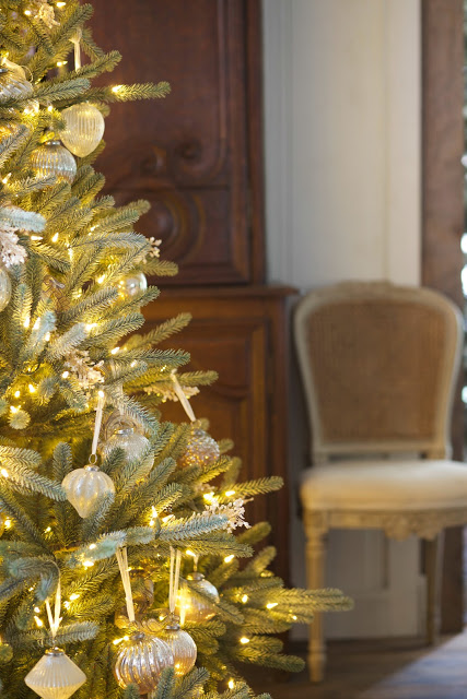 pre-lit christmas tree with french country decorations