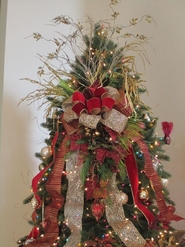 artificial Christmas tree decorate with silver and burgundy ribbons