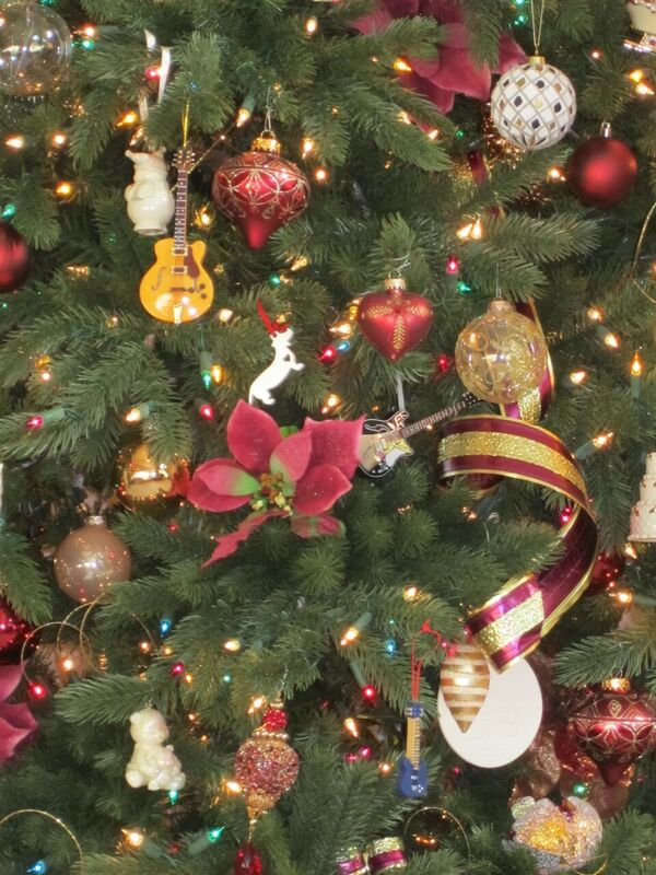 artificial Christmas tree decorate with silver and burgundy ornaments