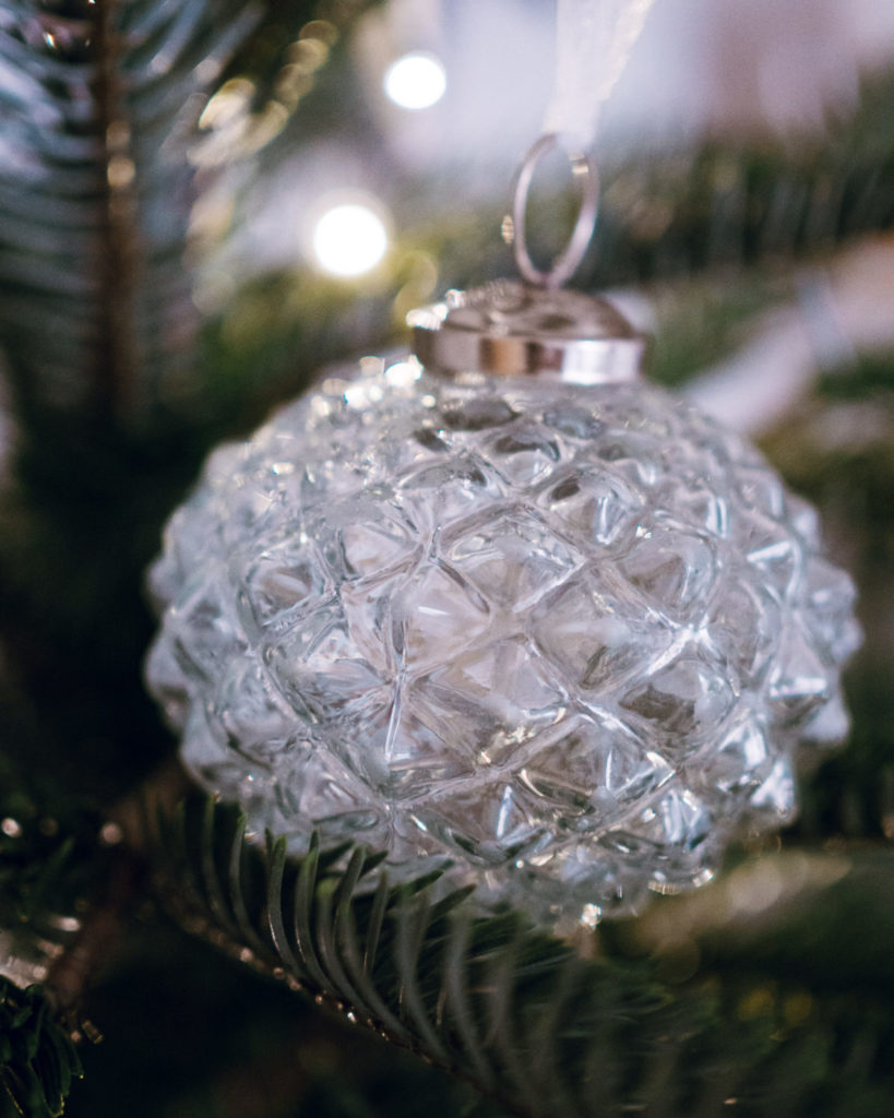 close-up of glass ornament on christmas tree