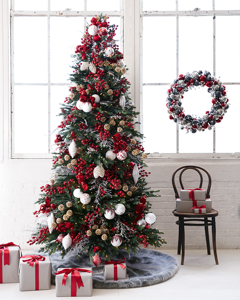 Artificial Christmas tree and foliage decorated with red and white theme