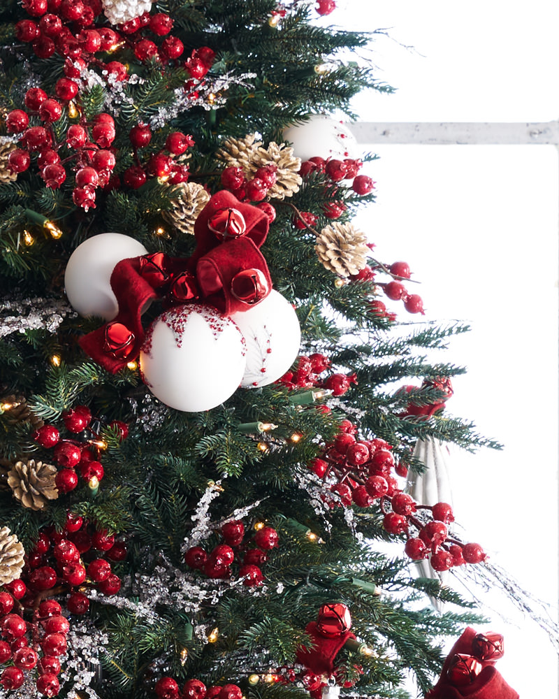 winter-inspired christmas tree decor with red and white trimmings