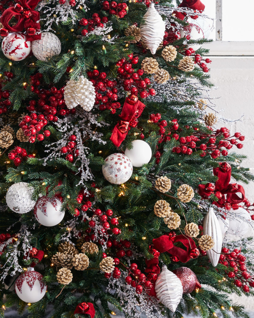 artificial christmas tree decorated with nordic frost winter-inspired theme