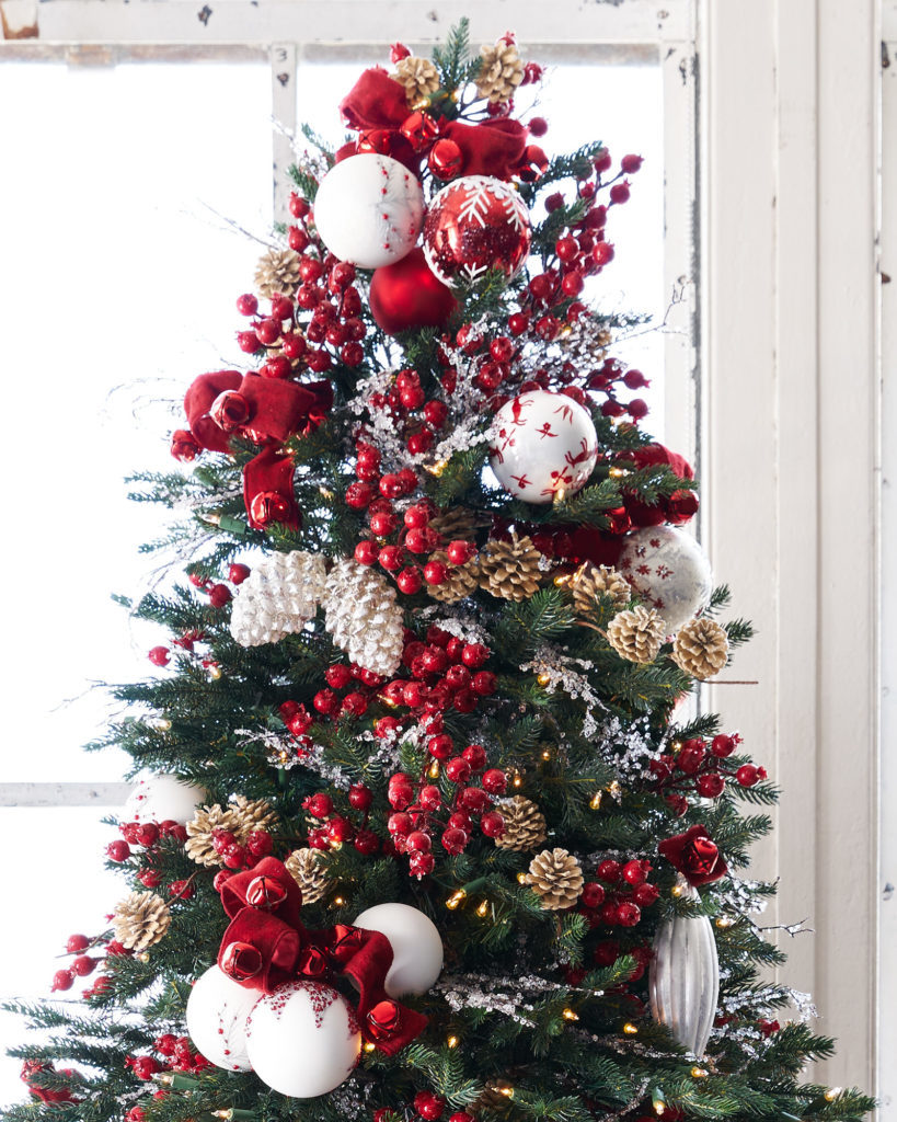 christmas tree with red, white, and metallic decor