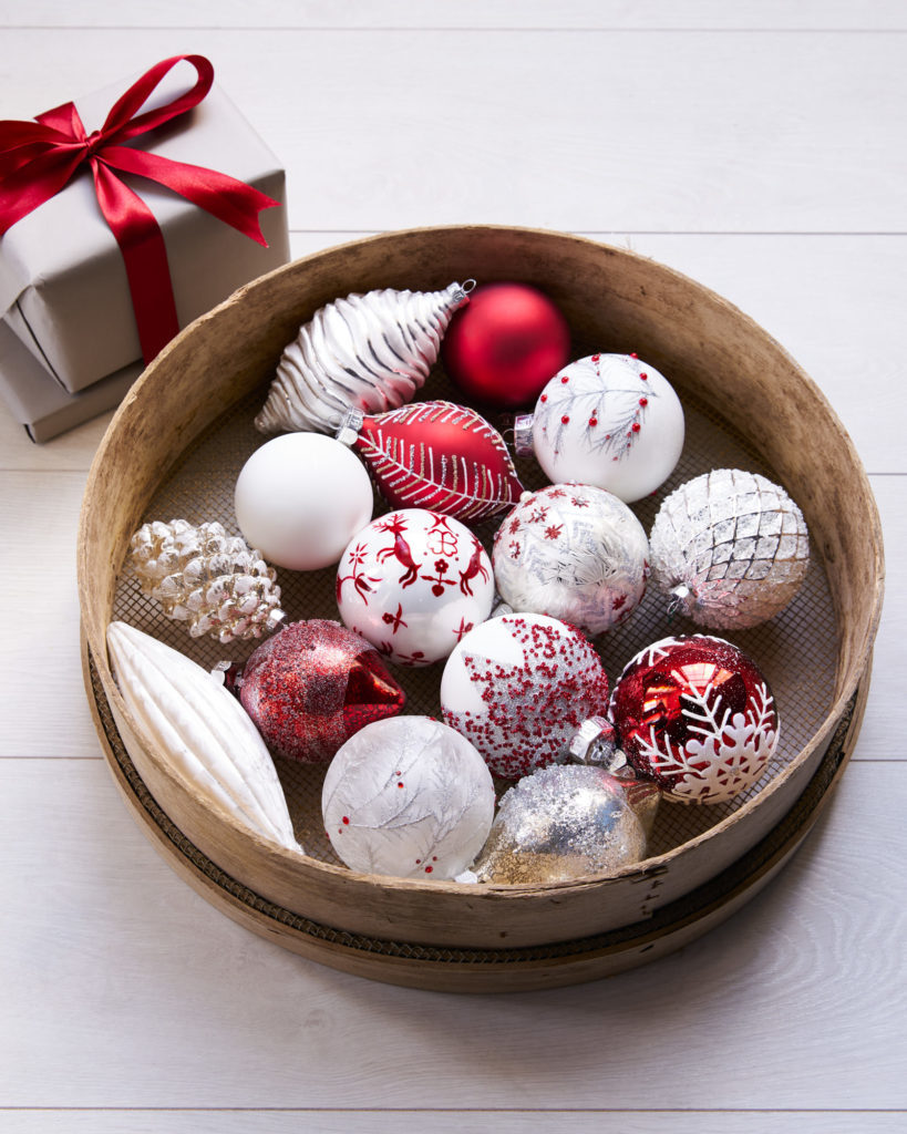 bowl of red and white tree ornaments