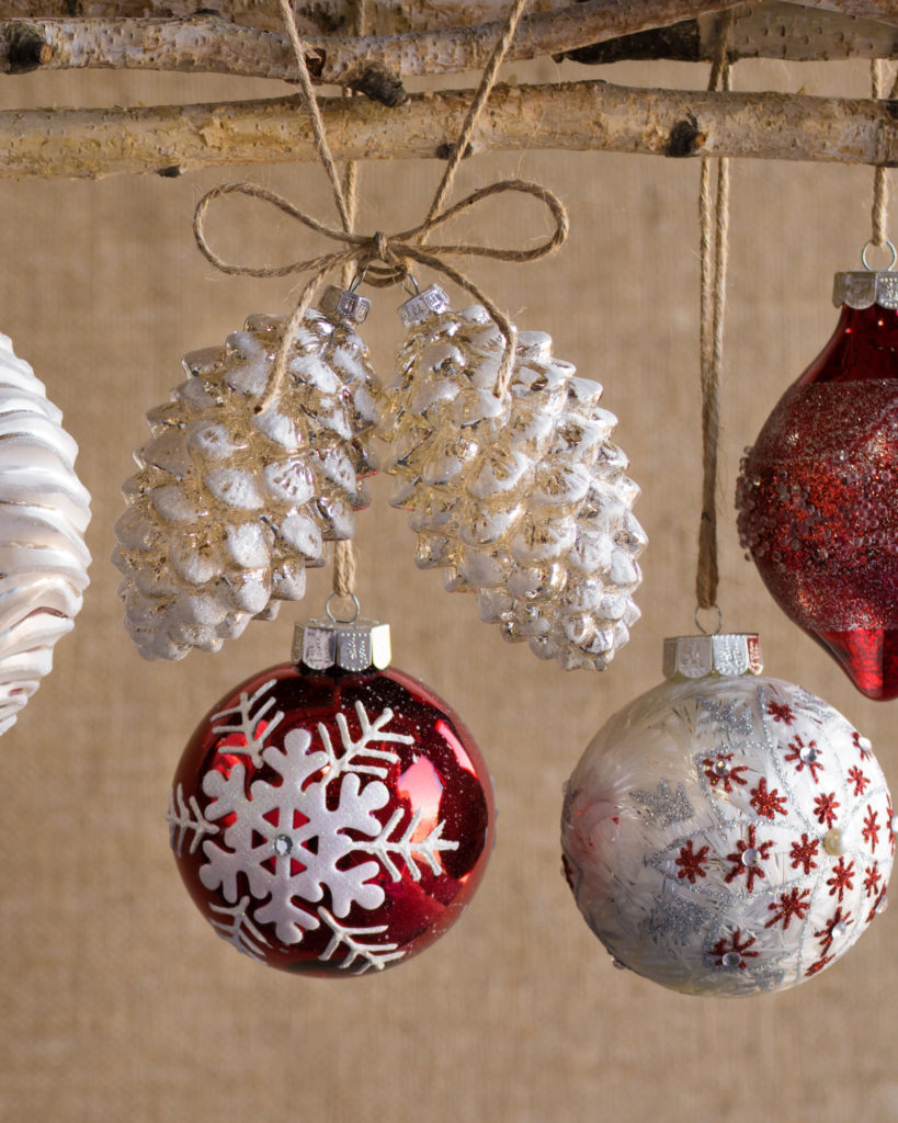 red and white ornaments hanging on twine
