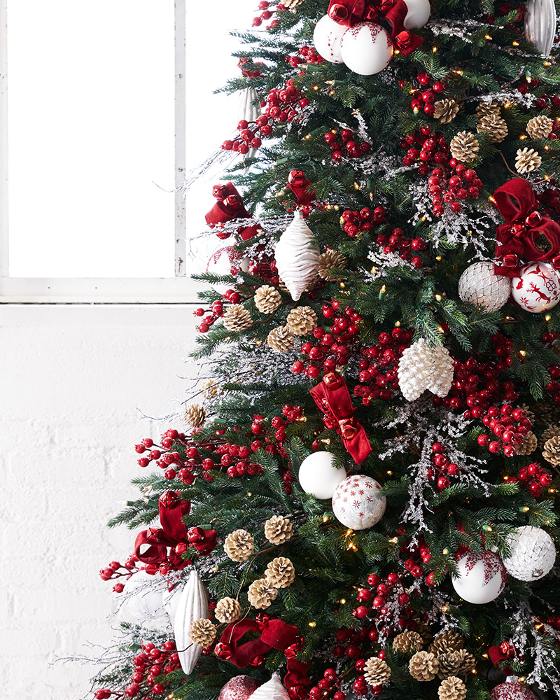 Artificial Christmas tree decorated with red and white theme