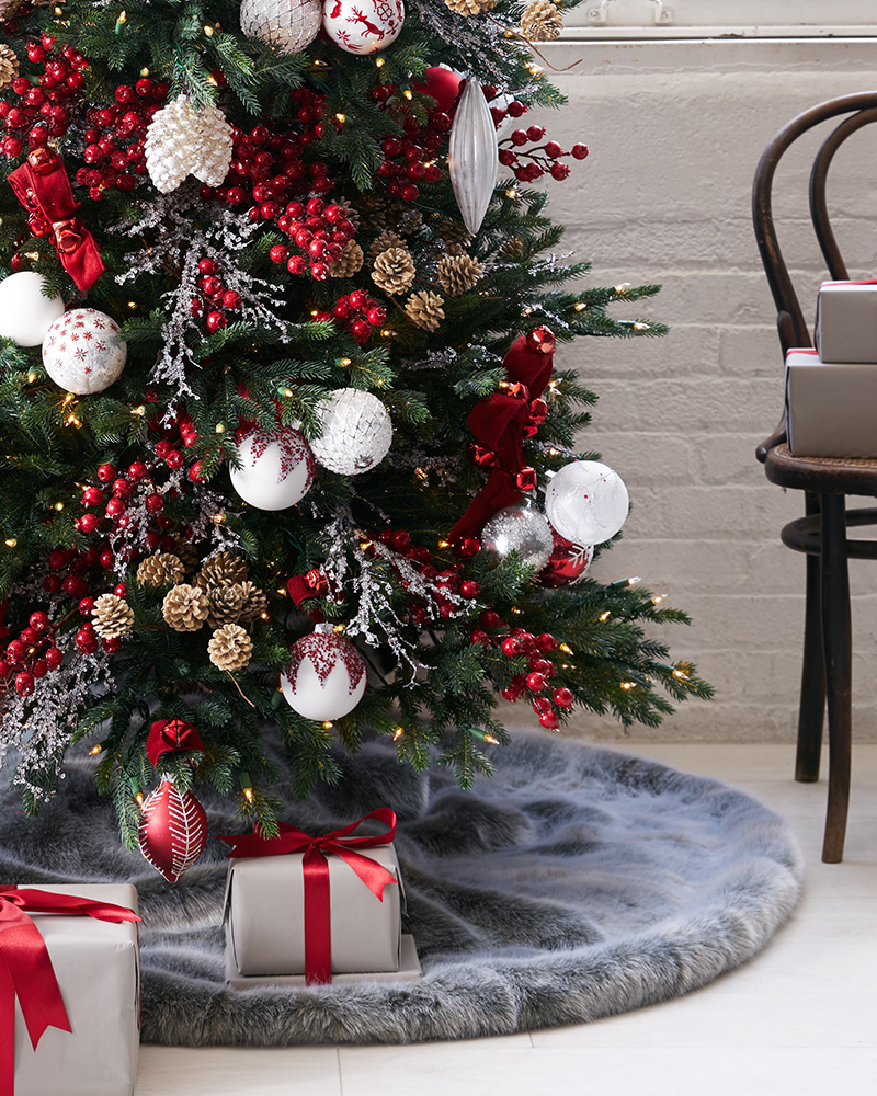 Artificial Christmas tree decorated with red and white winter-inspired theme