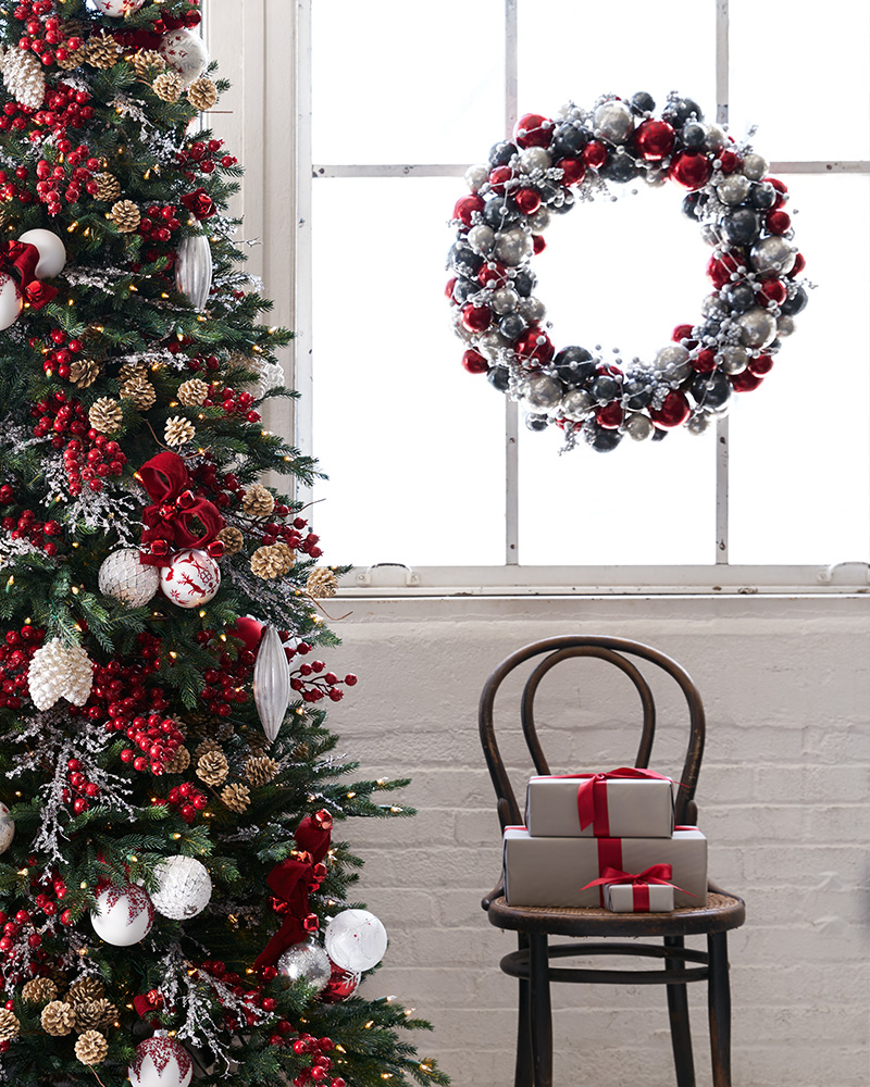 Artificial Christmas tree and wreath decorated with red and white theme