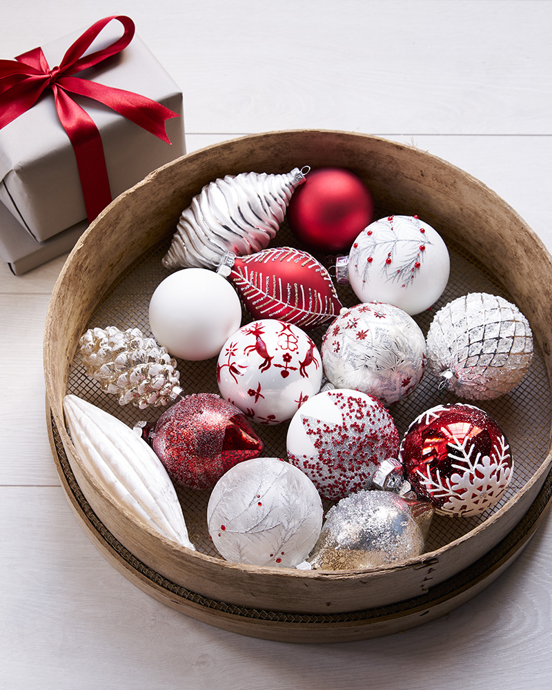 red and white christmas tree ornaments in a bowl